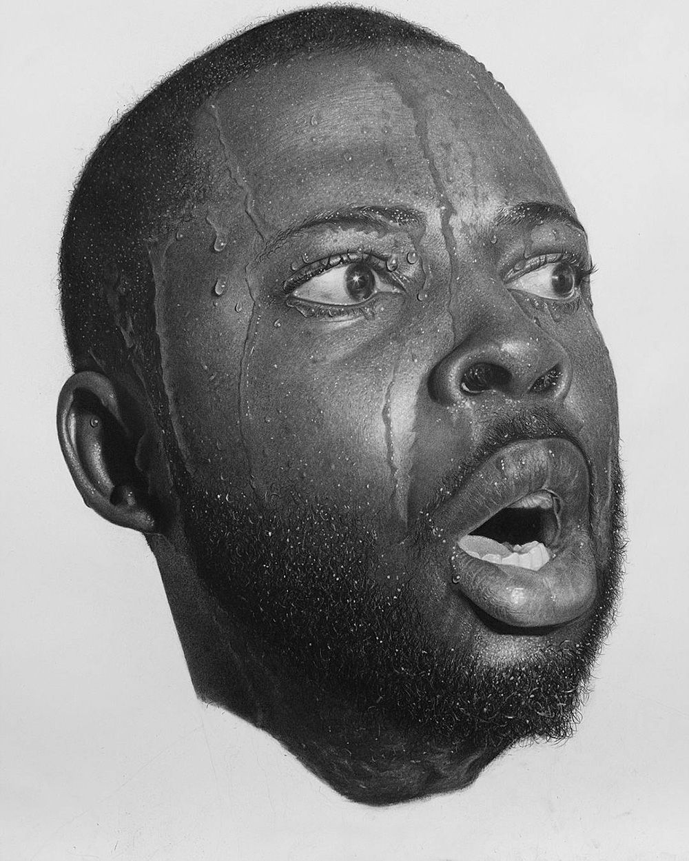 Larger-Than-Life Hyperrealistic Portraits Rendered in Graphite and Charcoal by Arinze Stanley | Colossal