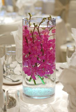 """4.79 SALE PRICE! This clear glasss 8.25"""" vase can be utilized in a myriad of ways. Made of 100% recycled glass, this cylinder vase has a slight green hue and..."""