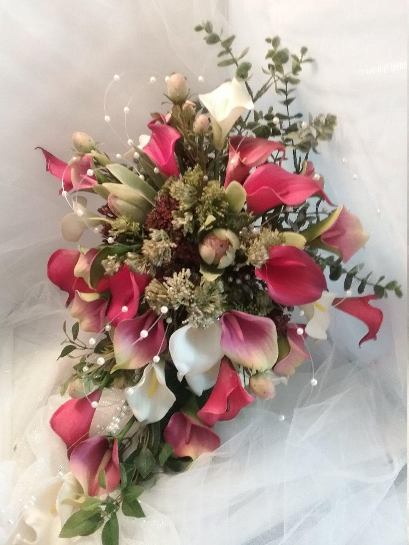 Calla lilies cascading cascadel bouquetweddingfall winter bouquet calla lilies cascading bridal bouquetwedding bouquetfall winter bouquet woodlandrustic izmirmasajfo Choice Image