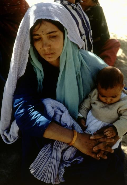 Woman with a sick child at a clinic. Kabul, Afghanistan. 1969.