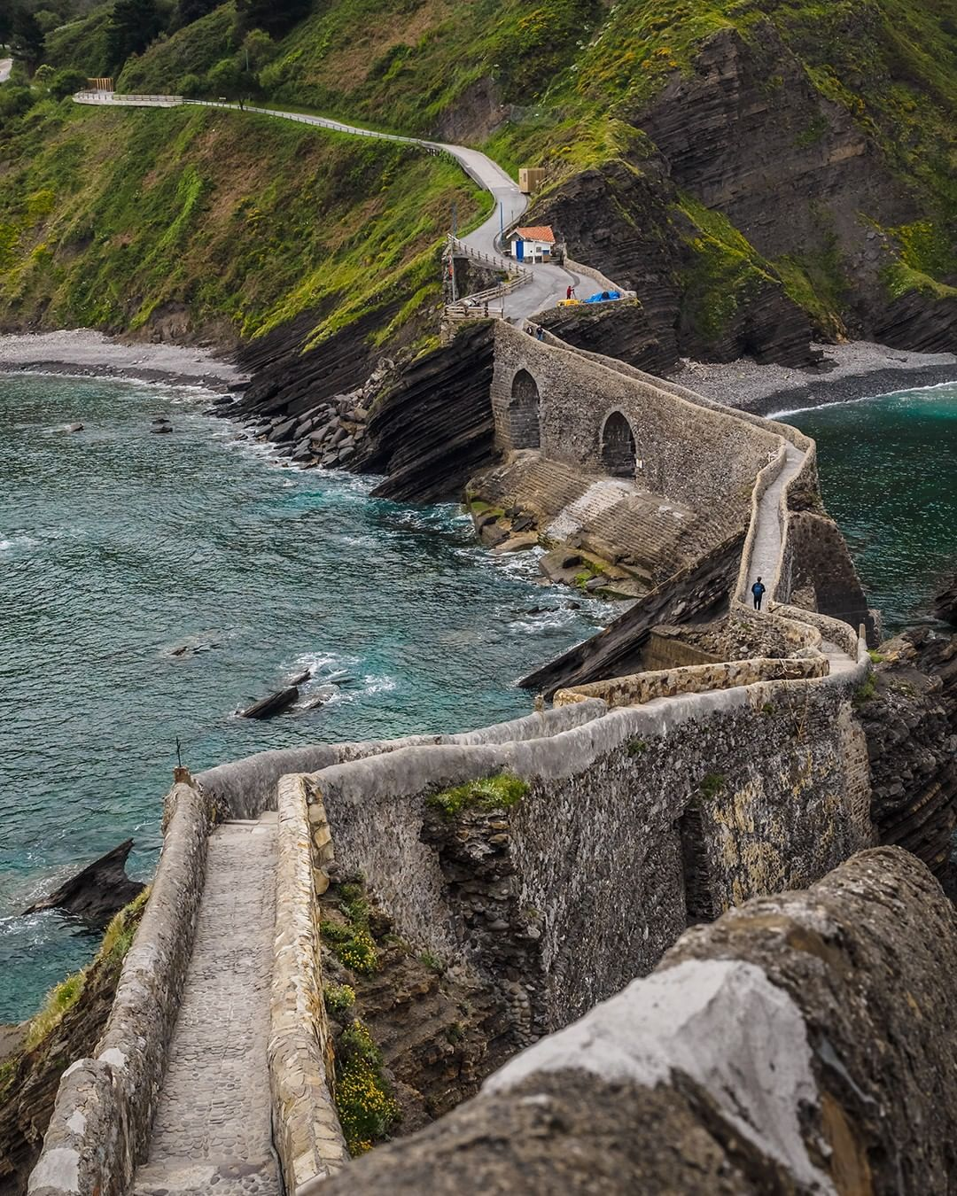 Zigzag Through The Island Of San Juan De Gaztelugatxe And Take In The Sights On A Picturesque Path You May Reco Travel Inspiration Travel Family Beach Vacation