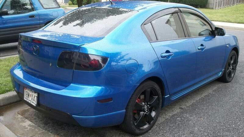 Blue Black First Gen Mazda Mazda3 Sedan With Visors Tinted Taillights Lip Spoiler And Black Painted Rims Red Calipers Mazda 3 Sedan Mazda 3 Mazda