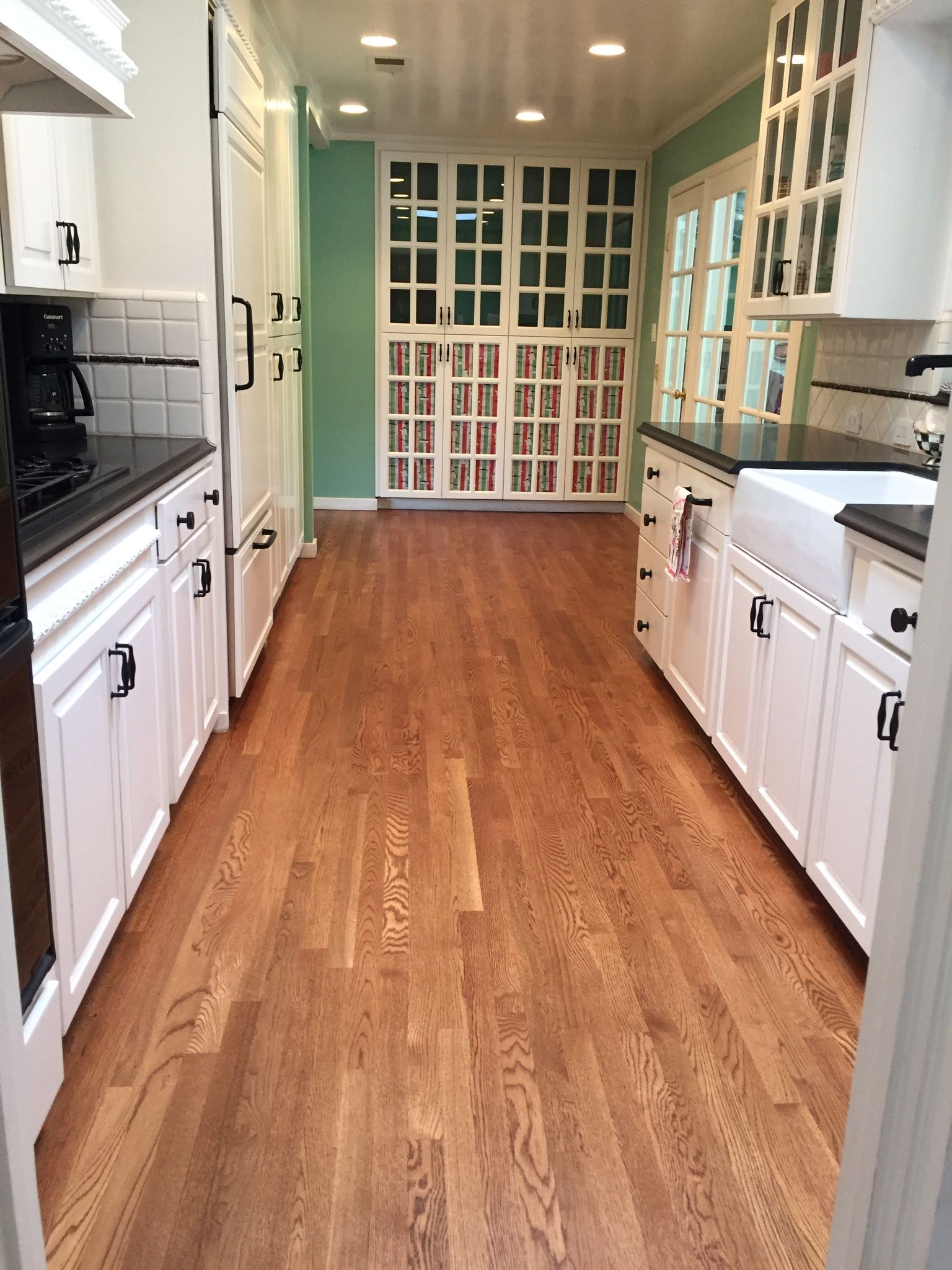 Kitchen floor white oak stained in English Chestnut
