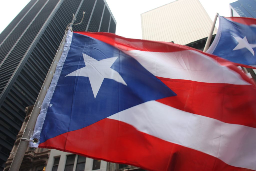 Puerto Rican flag obscures the WTC construction site during Occupy