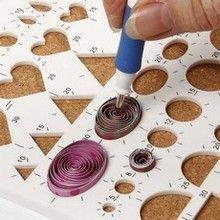 Quilling board... Link for more info:    http://m.cchobby.com:80/idea/12528-quilling-on-a-greeting-card.aspx