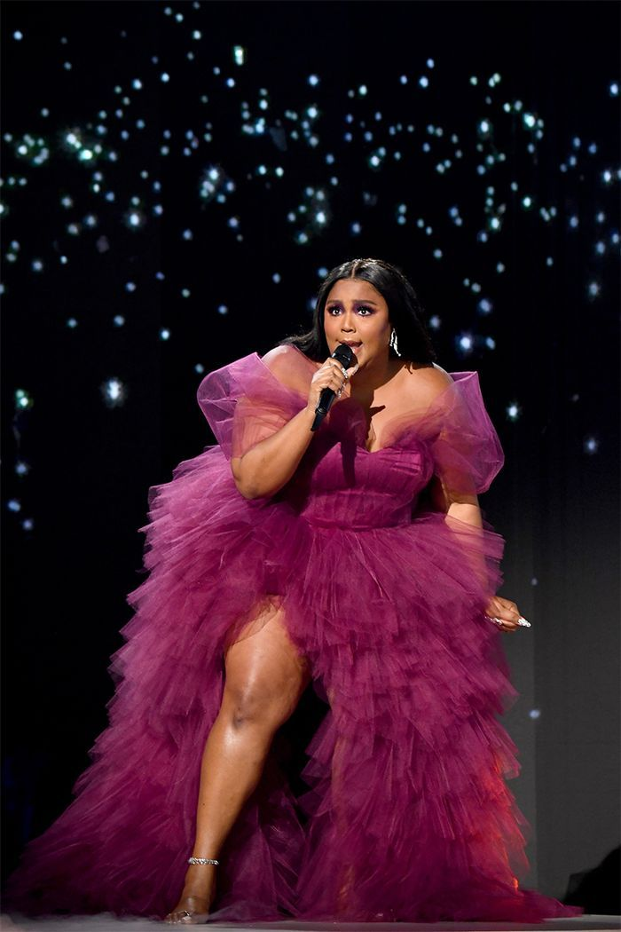 Lizzo performs onstage during the 2019 American Music Awards.