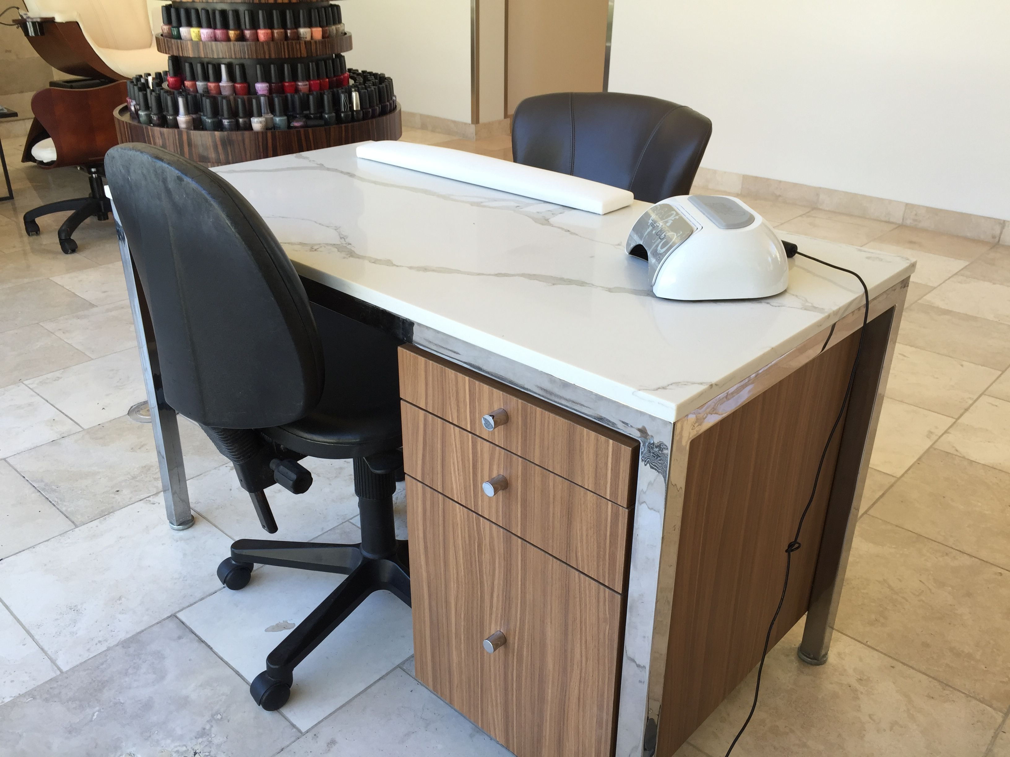 NQ06 countertop in use in a hair salon. Prior to approval a hair coloring sample was left on the countertop for three days, which did not stain! #Quartz #countertop #Daltile #slab