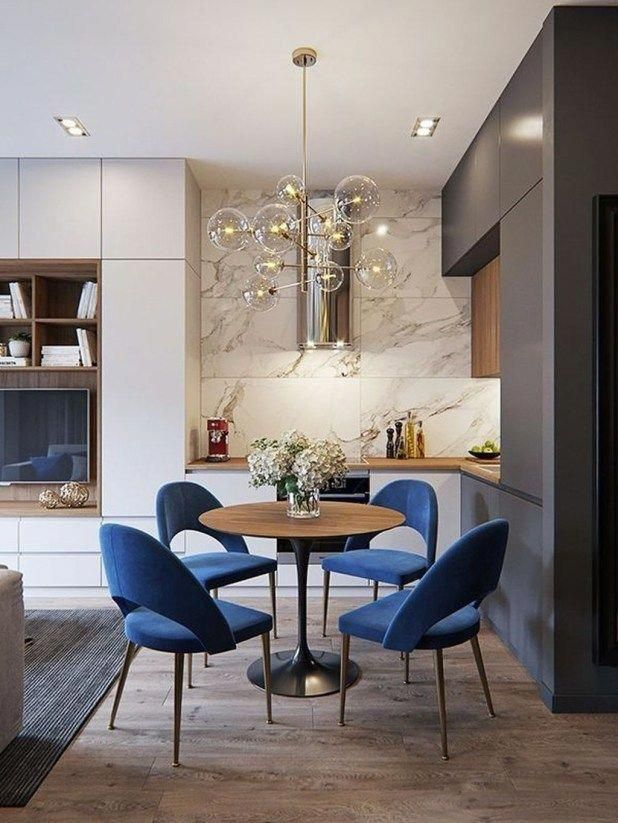 Gorgeous sleek blue velvet chairs accents all the woods tones in space goliath home interior designs also best small room design images rh pinterest
