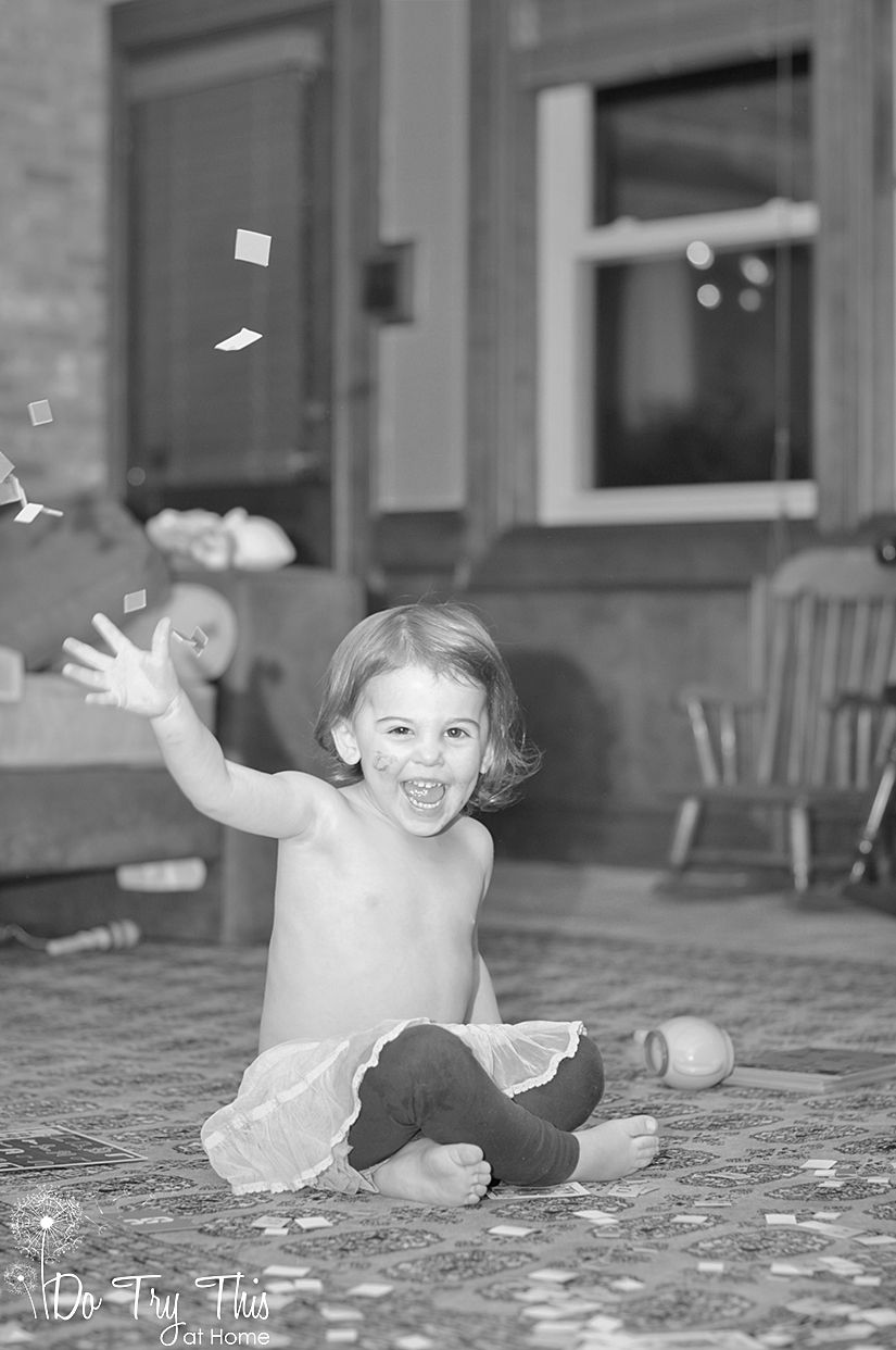 A cute black and white picture of a baby playing Bingo.  So to speak...