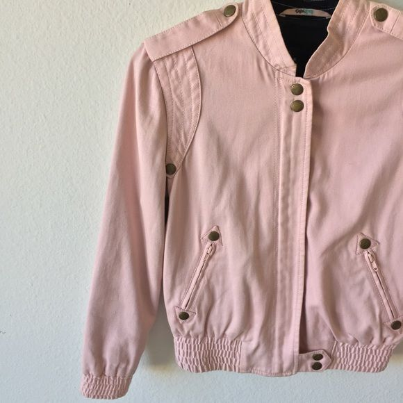 HP❤️Marc Jacobs Pink Bomber Jacket Host Pick for Casual Friday Party🎉Marc Jacobs bomber style jacket in light pink cotton. Dark bronze metal hardware. 3/4 length sleeves. Scrunched Elastic hem and elastic sleeves. Two side zipper pockets in front. Has some stains and discoloration. Has discoloration on collar. Has a couple of stains as well that are really minor. Still in wearable condition. There's some writing in marker on the hanger hook loop inside the jacket. No trades😊 Marc Jacobs…