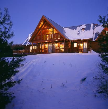 Illuminated log home in the White Mountains of New Hampshire at night