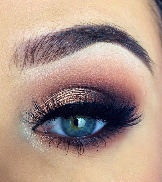 Gold and copper smokey eyes with a hint of navy blue.