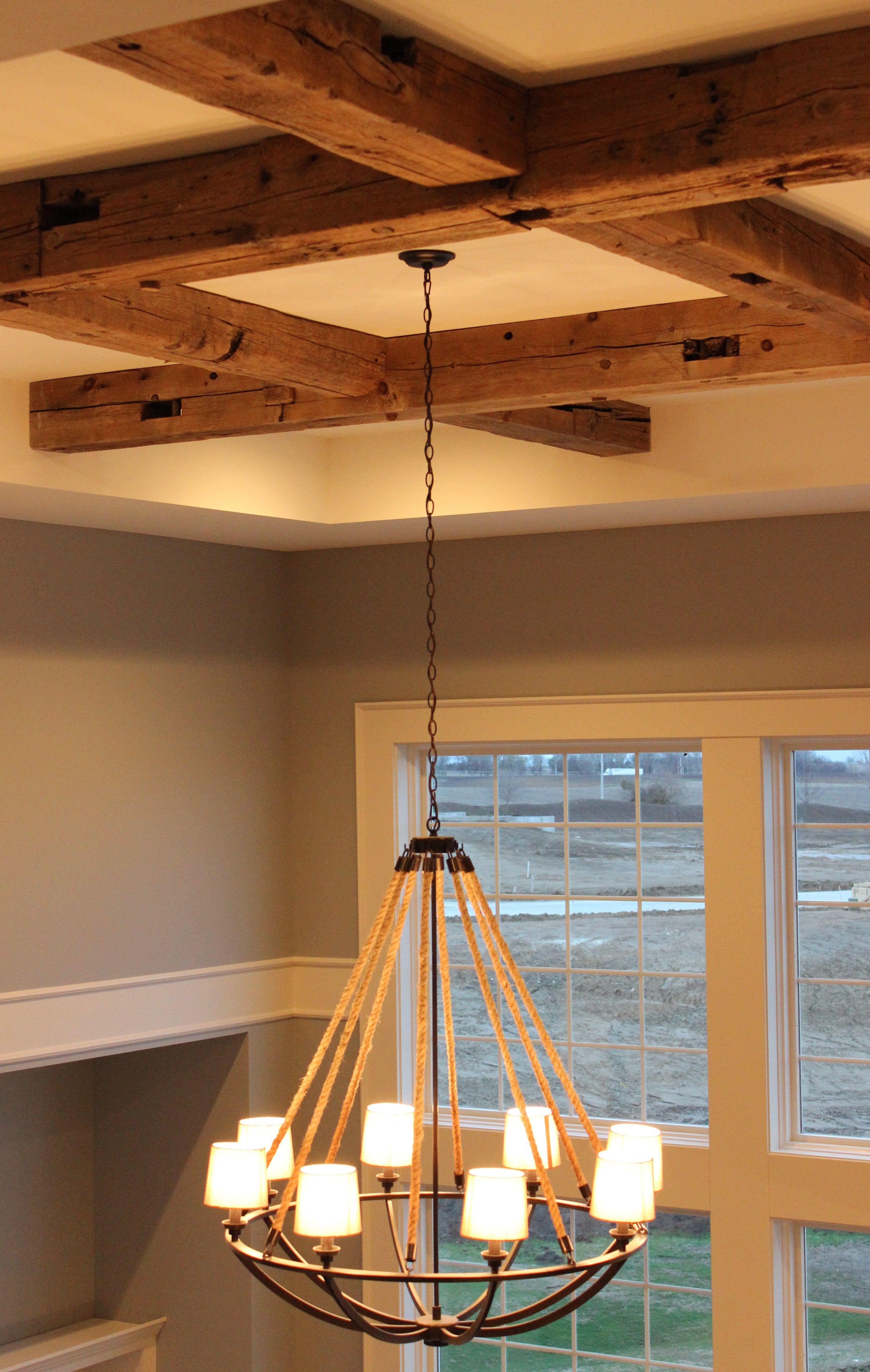 Beautiful Natural Rope Chandelier By ELK Lighting Hangs Beneath A Beam Ceiling Treatment
