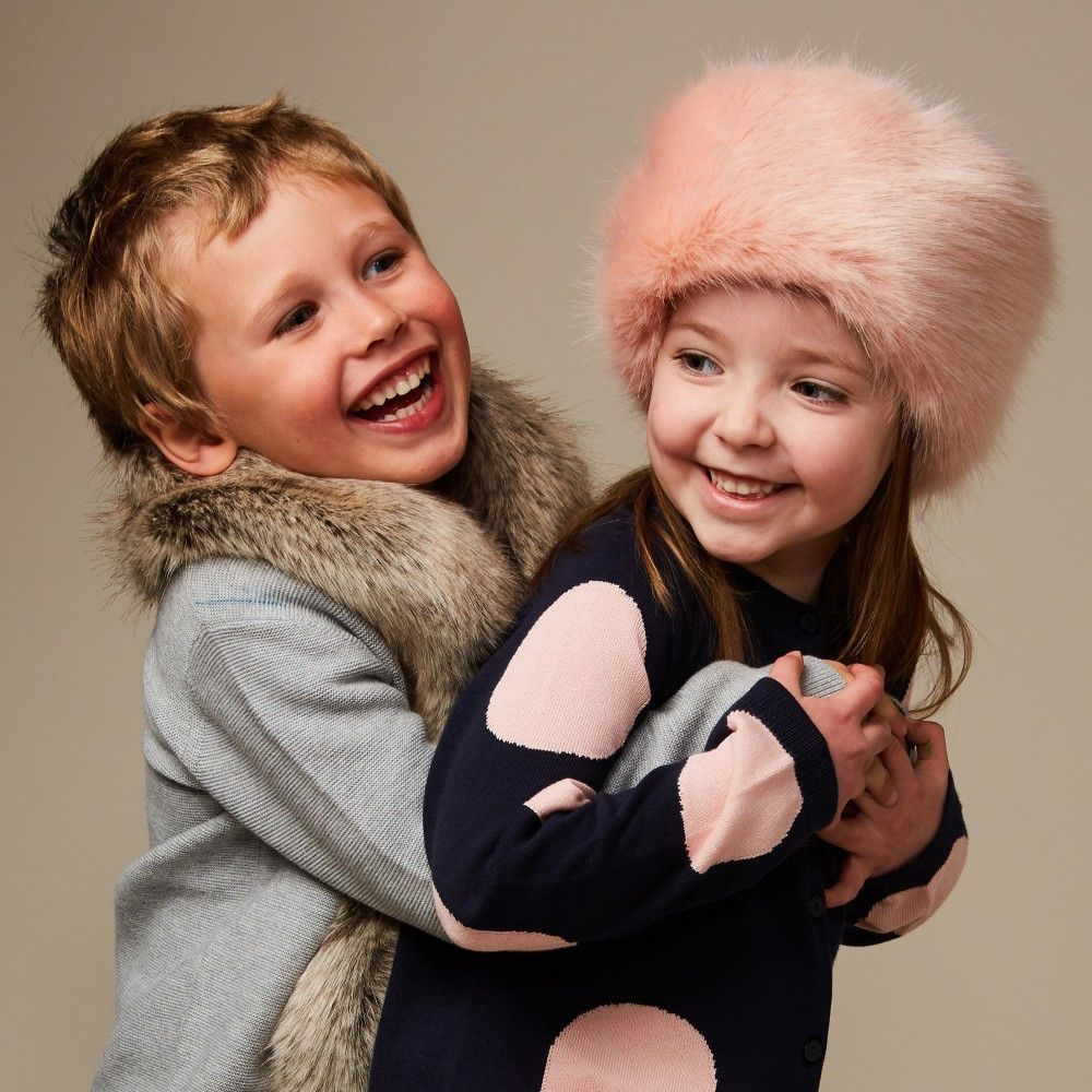 2510fd8a84aa Girls dusky pink pillbox style hat from Helen Moore. Made in luxuriously  soft synthetic fur