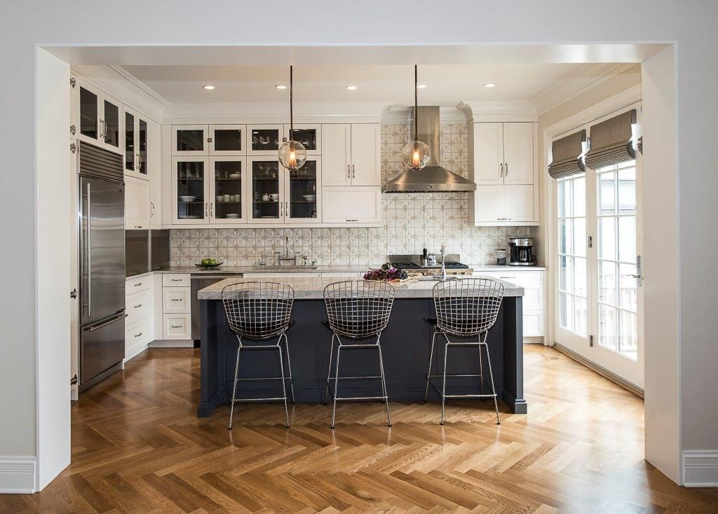 white kitchen, herringbone flooring, globe pendants ...