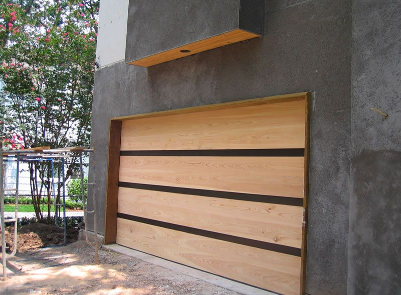Contemporary cypress garage door with architectural metal for Architectural garage doors