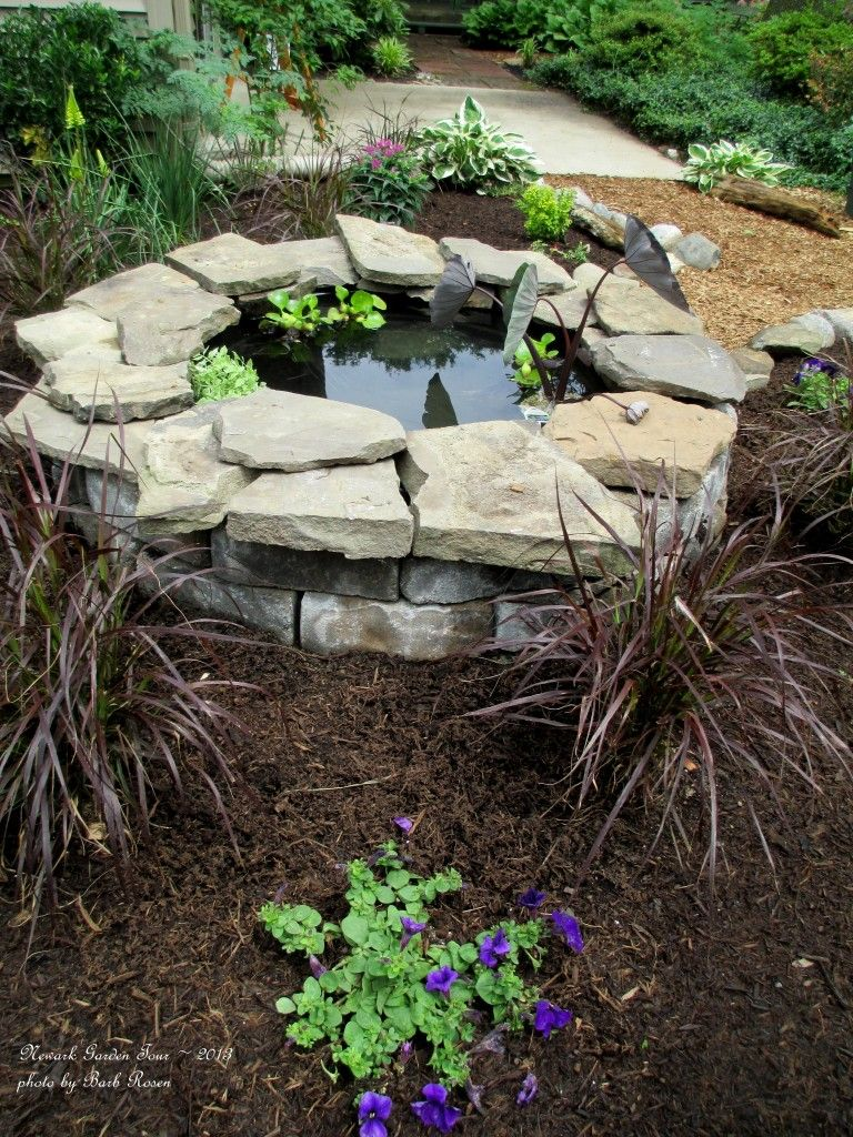 Small raised garden pond with flagstones backyard pond for Garden pond water features