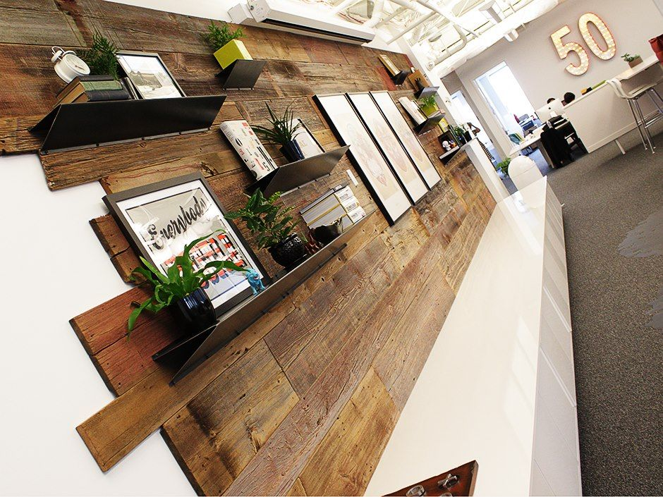 Reclaimed wood feature wall and custom branded lightbox for Feature wall interior design