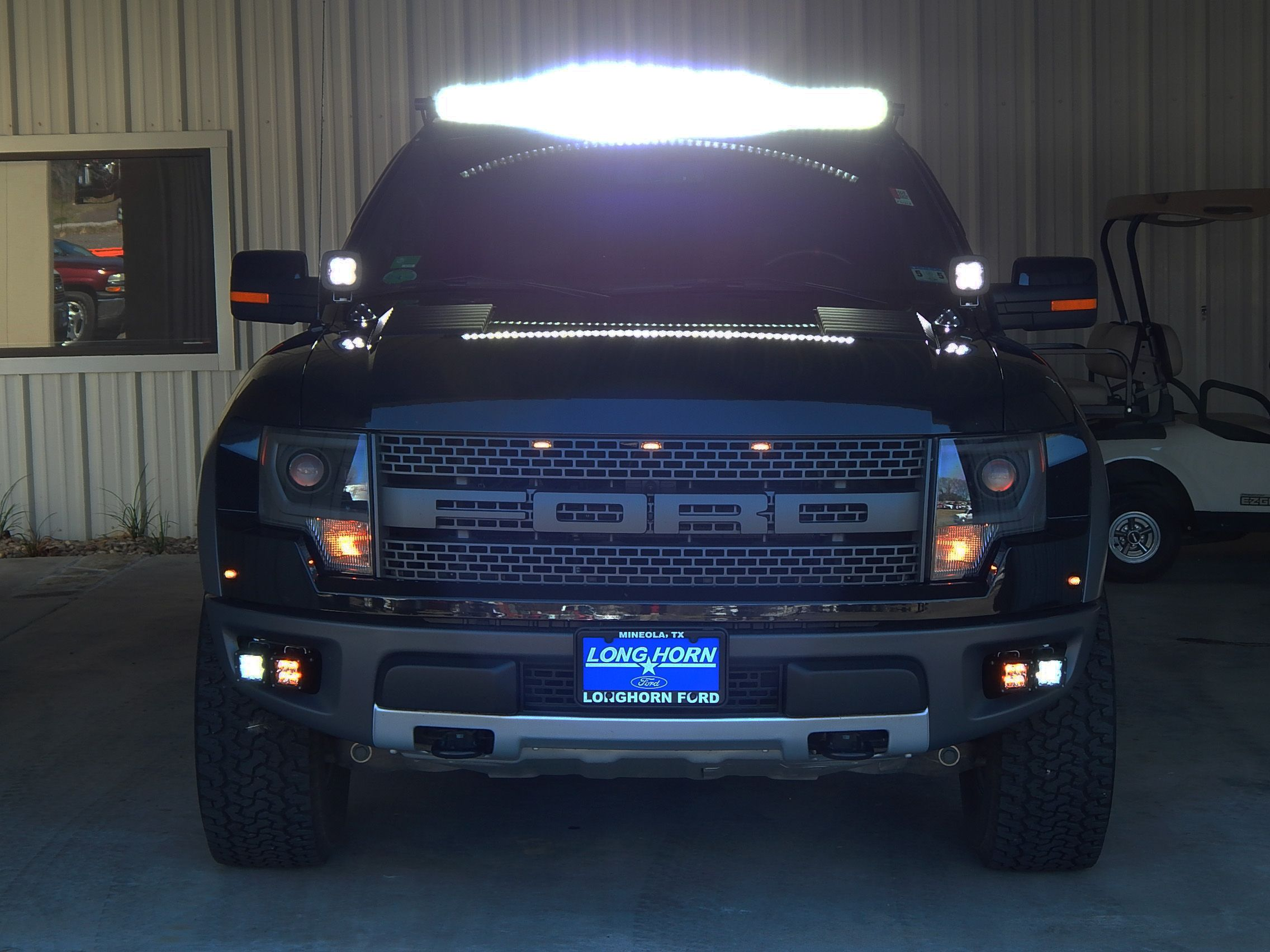 2014 ford f150 svt raptor with led light kits this beast has a 2014 ford f150 svt raptor with led light kits this beast has a bright side with an led light bar on the roof led spotlights and led backup lights raptor mozeypictures Choice Image