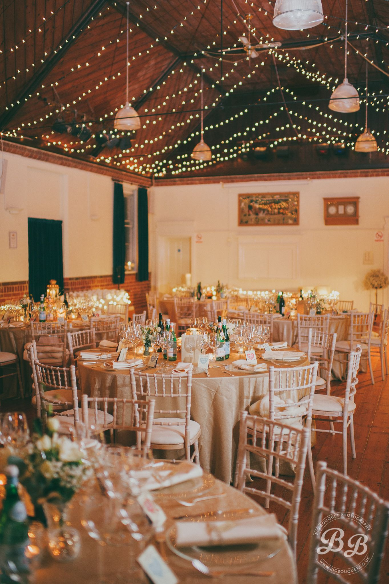 Light ceiling garlands to brighten up a village hall for winters ideas and inspiration for creating a beautiful village hall village fete styled wedding reception light ceiling garlands to brighten up a village hall junglespirit