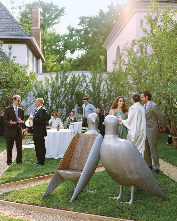 Cucumber martinis helped keep the 150 wedding-goers cool, while Lalanne dove chair-sculptures kept them amused.