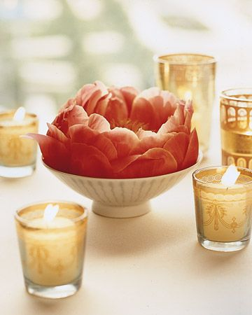 Place single peonies in porcelain bowls and surround with festive votive candles for a unique and romantic centerpiece