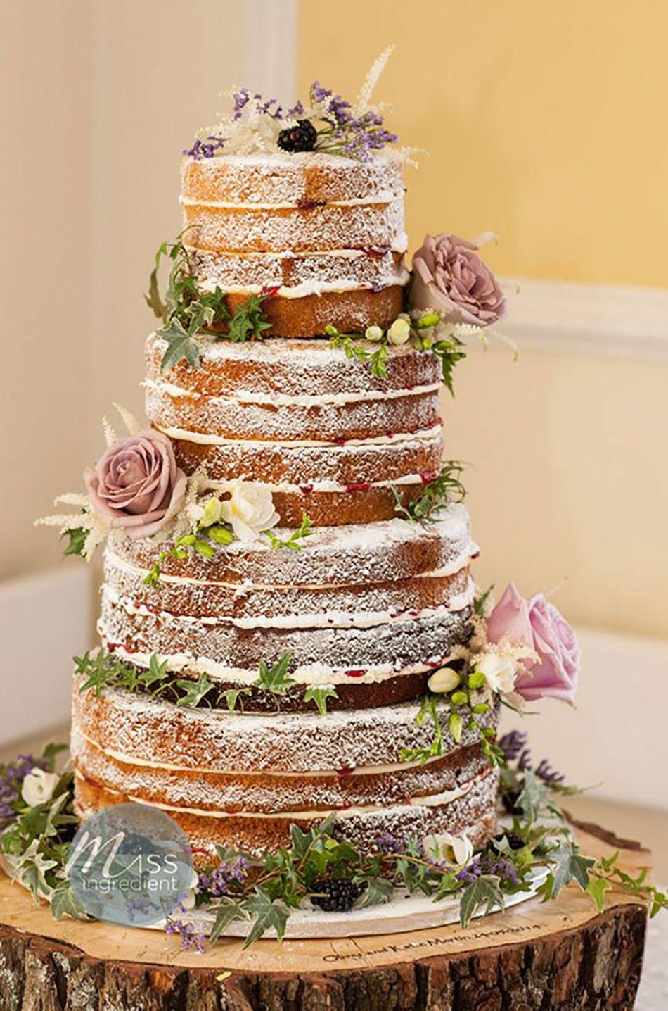 Naked wedding cake with large pink flowers Naked wedding