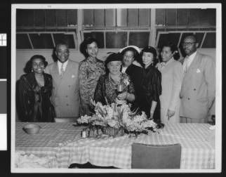 Charlotta Bass at a celebration with the staff of the California Eagle, Los Angeles, ca. 1951-1960 :: Charlotta Bass / California Eagle Photograph Collection, 1870-1960