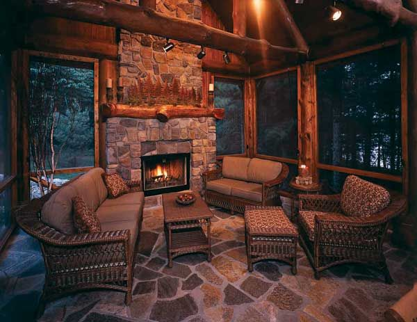 Pine logs provide the framework for the screened porch for Wood burning stove for screened porch