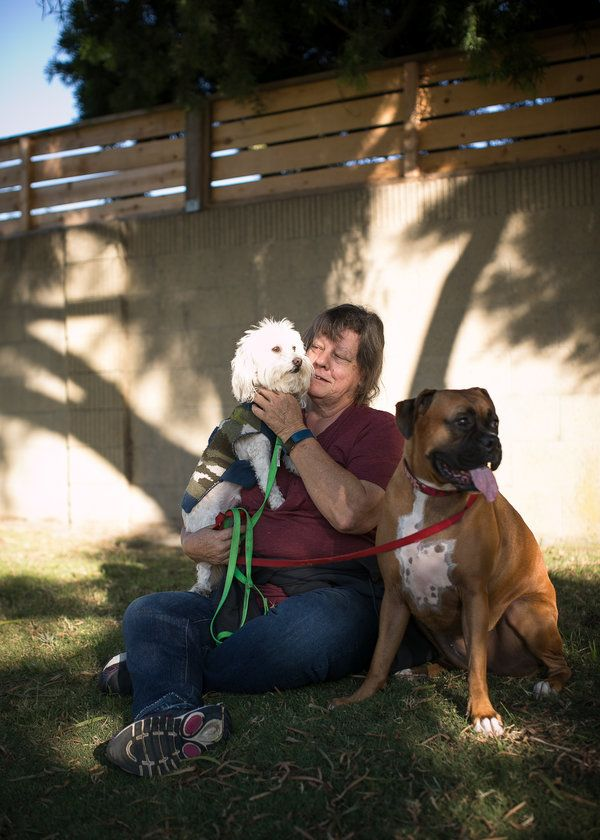 When Kathy Klute-Nelson heads out on a neighborhood walk, she often takes her two dogs — Kona, a b.....