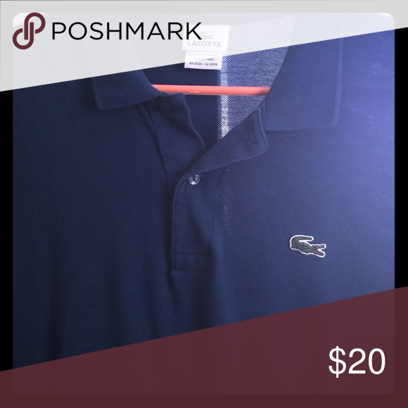 Blue Lacoste polo XXL size 9 Blue Lacoste polo XXL slightly used size 9 Lacoste Shirts Polos