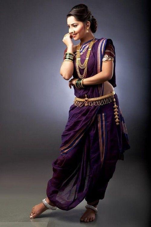 Traditional maharashtrian nine yard sari; modern descendant of the antariya worn around the time of the Buddha.