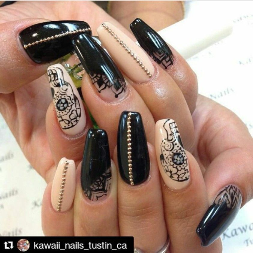Black and nude coffin nails with skull designs