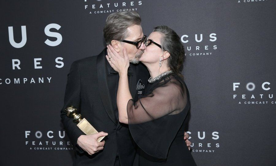 Focus Features After Party  Gary Oldman, recipient of the Best Performance by an Actor in a Motion Picture - Drama award for Darkest Hour, received another prize – a kiss from wife Gisele Schmidt – at the Focus Features Golden Globe Awards After Party.