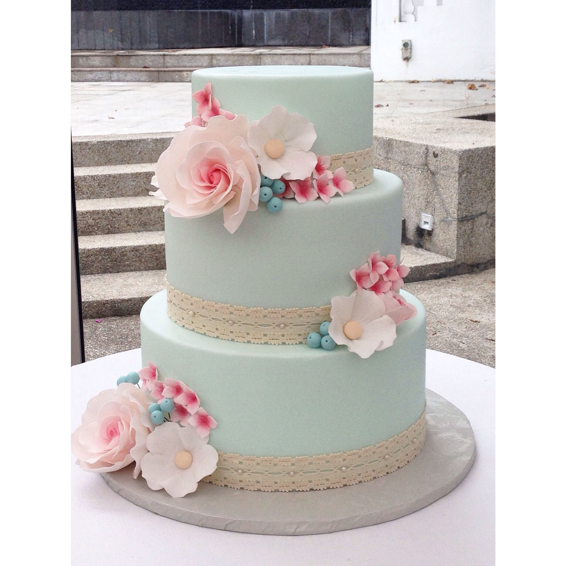 A 1950s inspired wedding cake with mint fondant and pink a 1950s inspired wedding cake with mint fondant and pink sugarflowers by crummb singapore izmirmasajfo