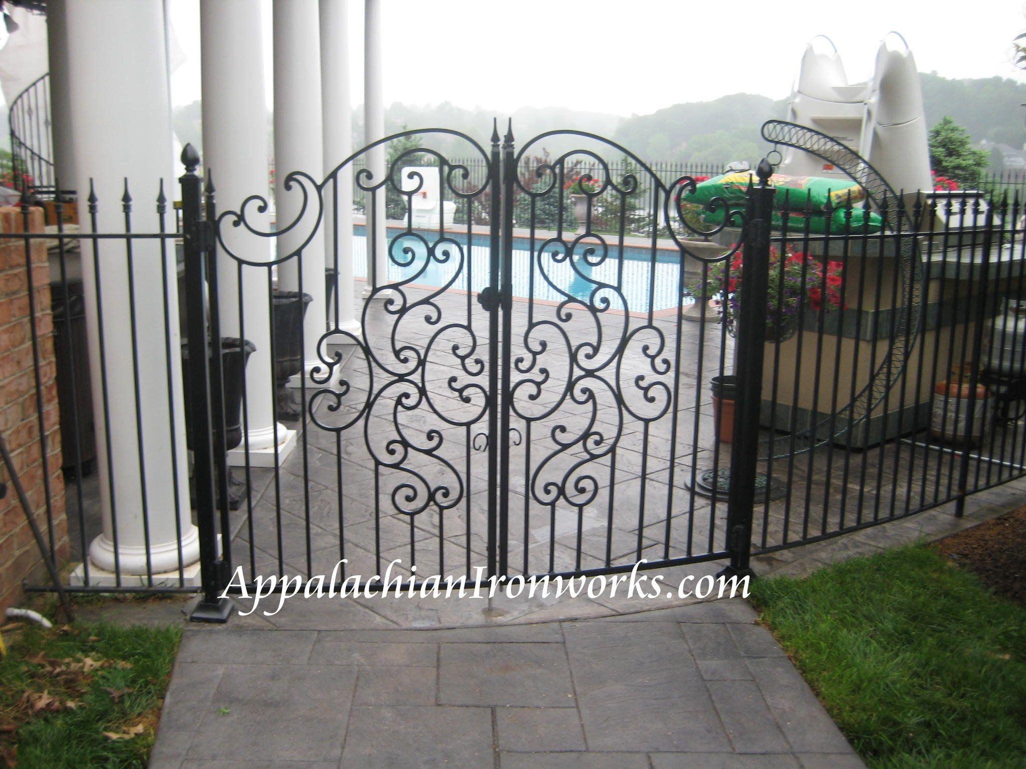 ironwork va decorative curved iron gate near pool with