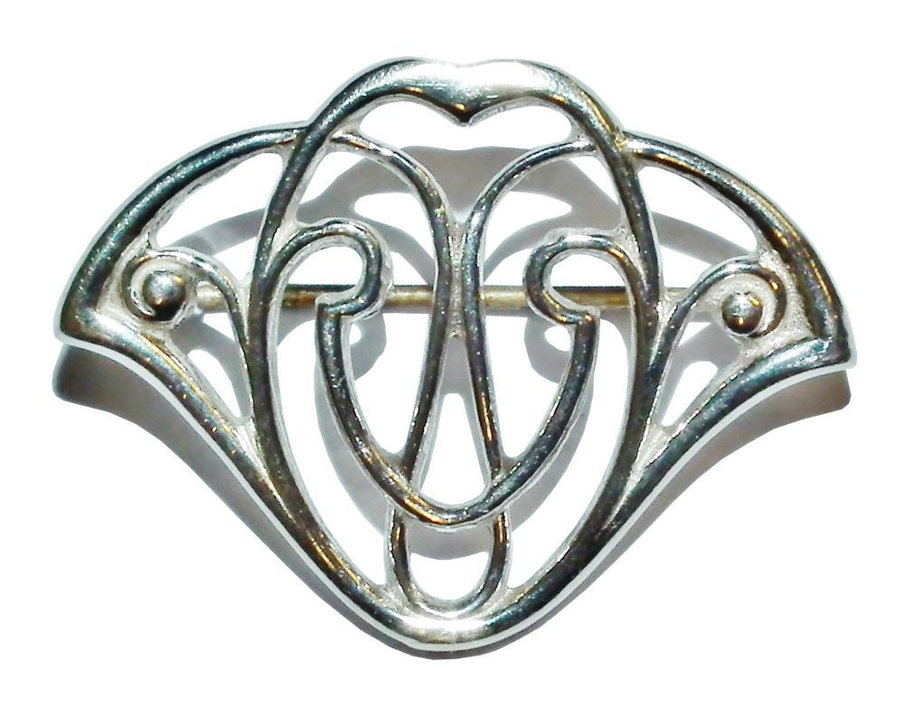Stamped  SILVER , Sterling Silver Fancy Brooch With Base Metal Pin