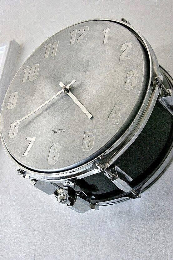 Recycled drum transformed in clock