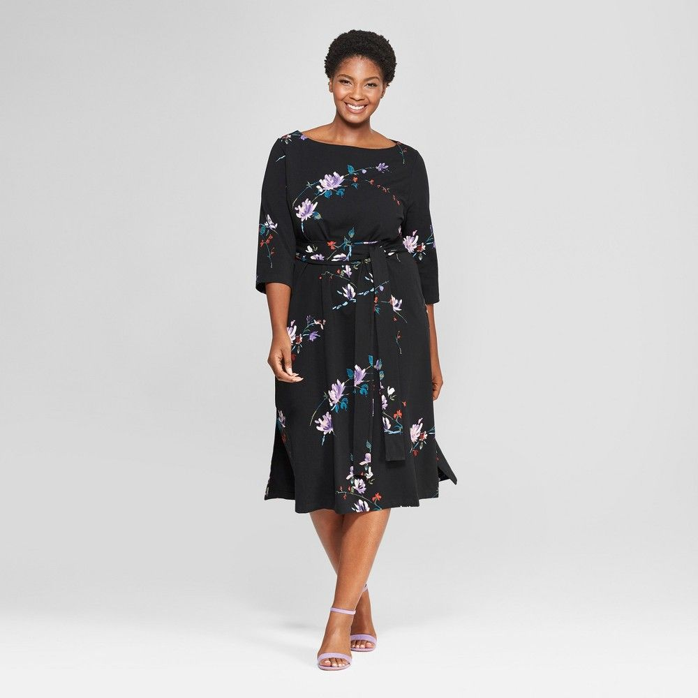 5ba2435519be5 This Floral-Print Midi Wrap Dress from Ava and Viv may just be the dress of  your dreams. Red and purple flowers bloom against black cotton-blend fabric  for ...