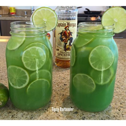 MERMAID WATER  2 oz (60 ml) Captain Morgan Spiced Rum  1 oz (30 ml) Coconut Rum  6 oz (180 ml) parts Pineapple Juice  1/2 oz (15 ml) Lime Juice  Top off with Pineapple Juice  Splash Blue Curacao  Garnish with Lime Wheels