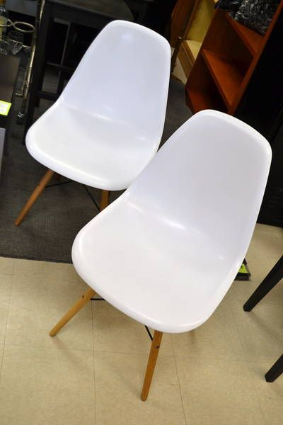 "Pair of White ""Structube - Eiffel"" Molded Polypropylene Seats with Beech Wood Legs Supported by Black Metal Bar Legs - Eames Reproductions - Great for a workspace! - 18.25"" W x 17"" D x 32.75"" H x 17"" Seat Height"