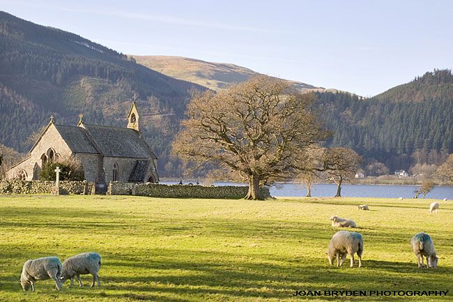 a lake district wedding church stands by a lake