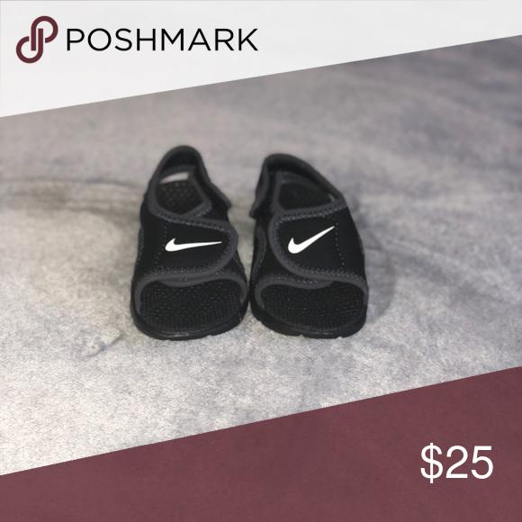 Never worn infant Nick slippers | Nike