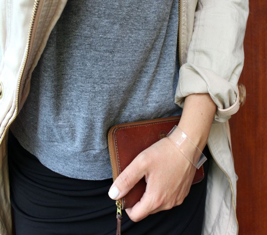 Wallet from Acne and plexi bracelet from Cooee.