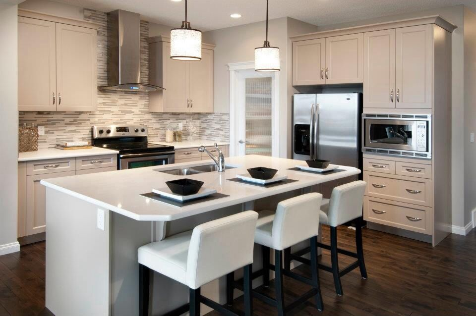 Ivory & white kitchen, love the bar stools too!