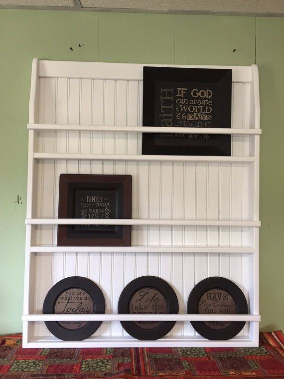 THIS IS A SOLID PINE HAND CRAFTED PLATE RACK OR BOOKSHELF FOR YOUR CHILDS ROOM IT 40 INCHES TALL 32 WIDE AND 25 DEEP WILL HOLD 11