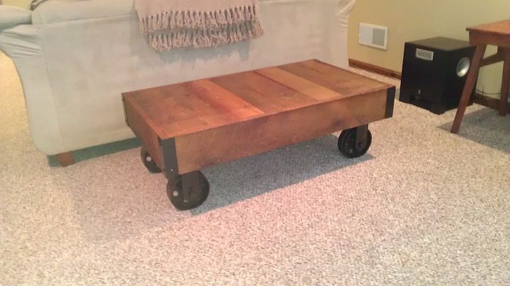 Coffee table I built from salvaged lumber and casters I scored from PPG