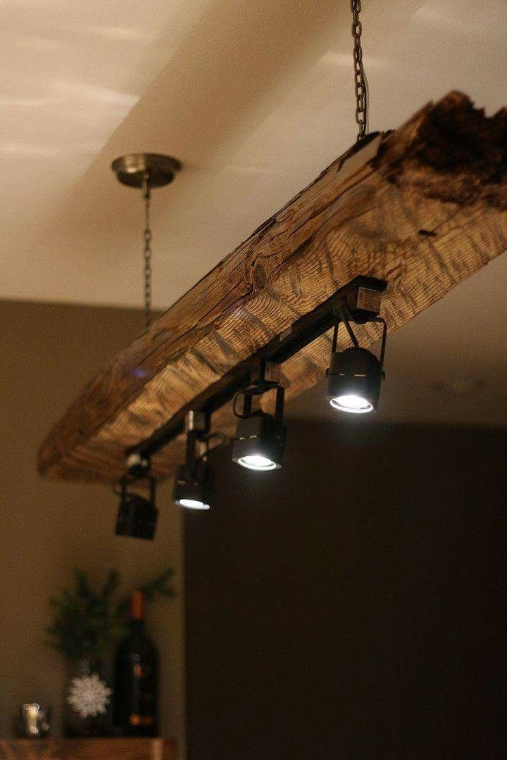 rustic industrial lighting. not sure about that particular hunk of wood but i do like the concept rustic industrial lighting