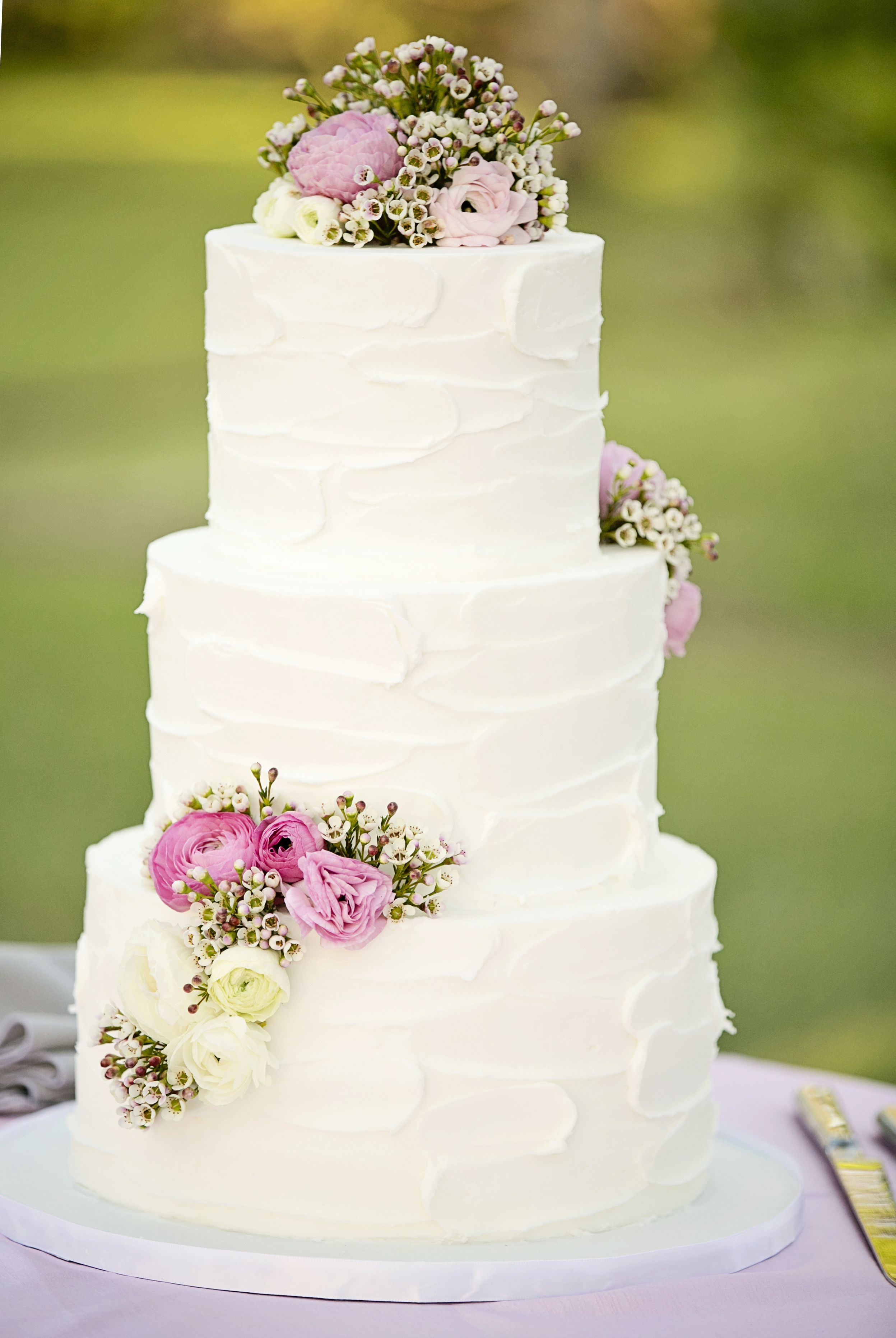 White 3-tier rustic stucco buttercream textured cake, accented and ...