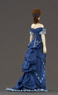 Anne (1880-1883) Silk dress inspired by an engraving published in the feminine magazine La Moda Elegante. Trimmed with silk thread embroideries and drapes. Carabosse Dolls (back view)Click to enlarge